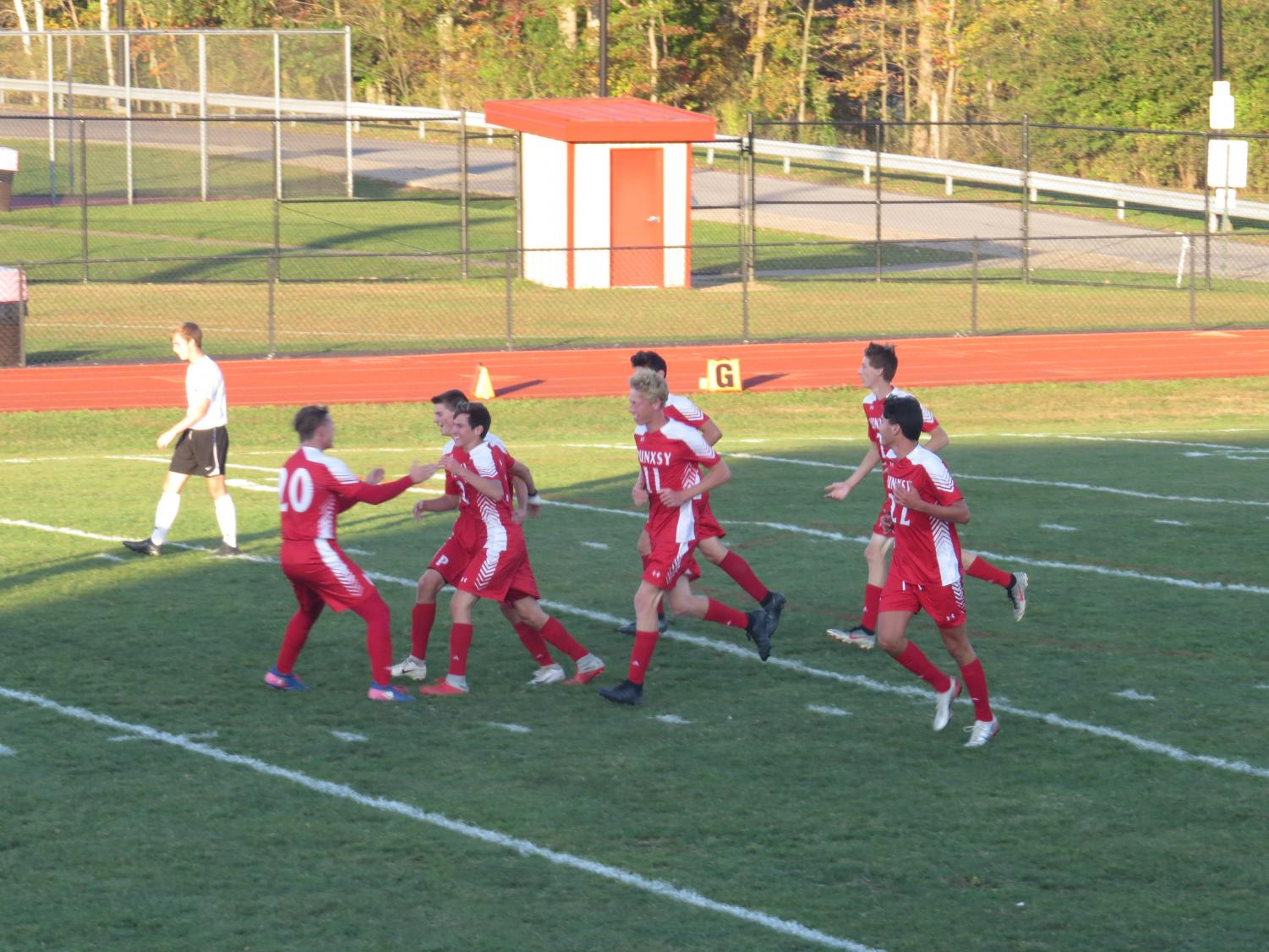 Team congratulates Gigliotti after breaking the school record for most goals in a single season