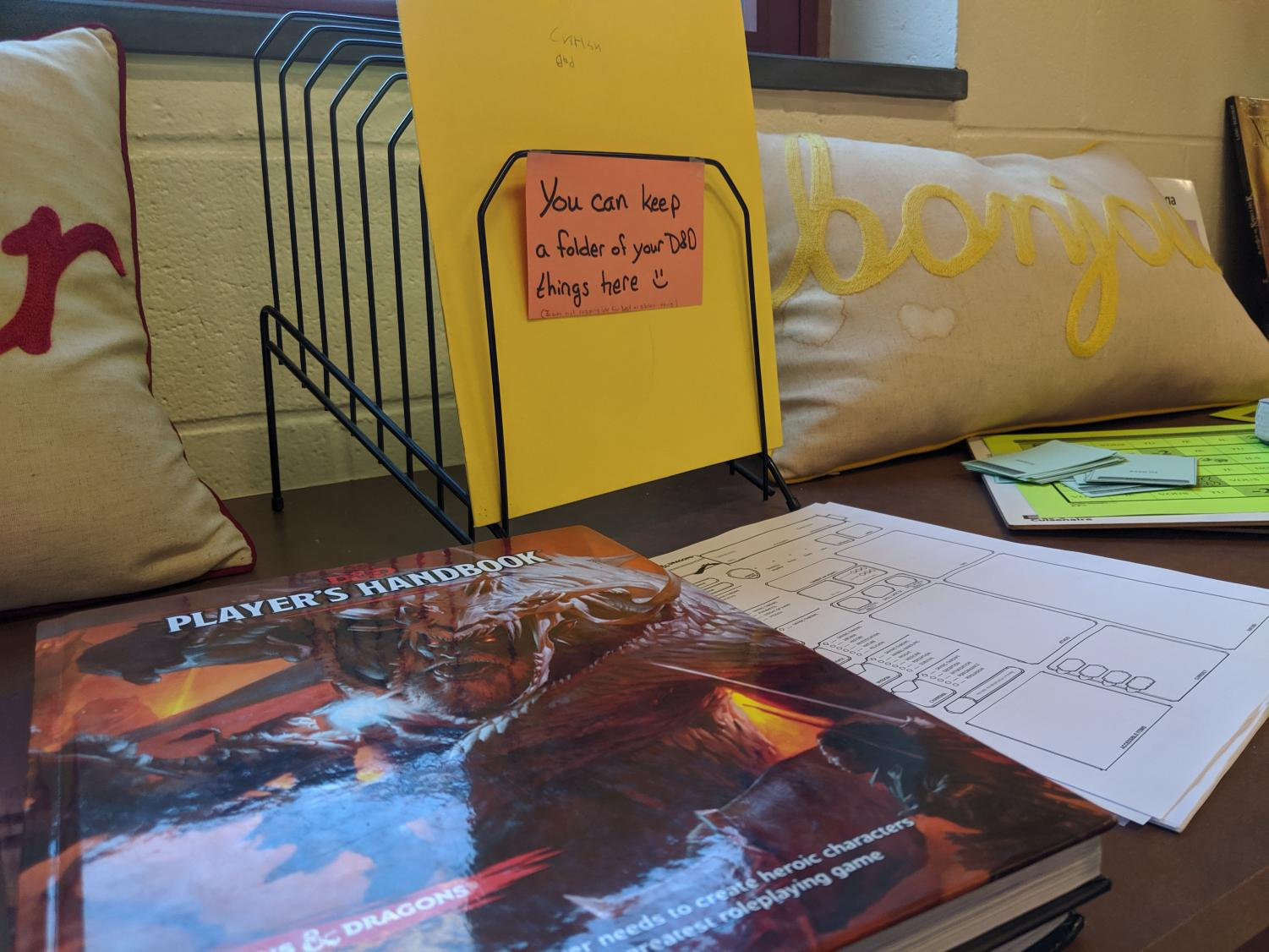 Club adviser Lisa McMeekin keeps the D&D Player's Handbook and character sheets on a shelf in her classroom.
