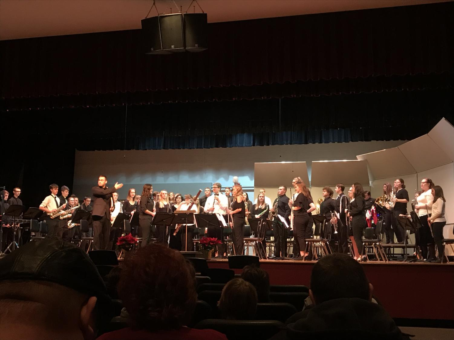 High School band files onto the stage before performing their first piece.
