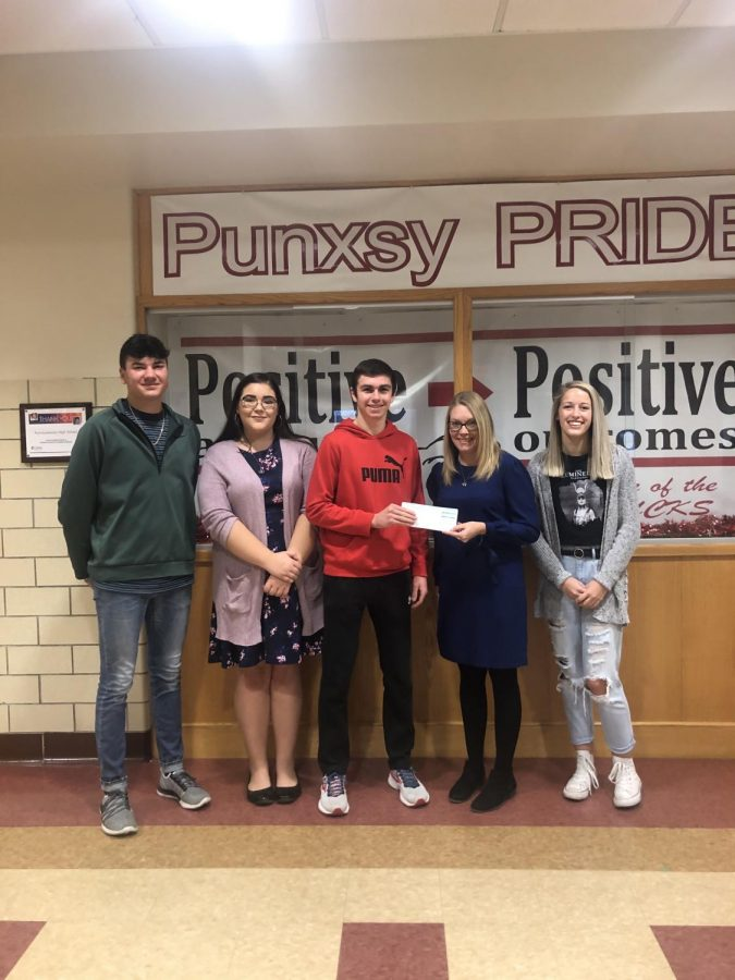 Members of Student Council present Lacy Bair with check for Make-A-Wish