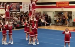 The cheerleaders perform a pyramid stunt at districts.