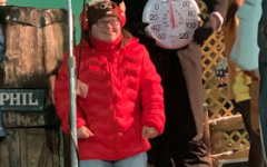 Jillian stands on stage with PAHS math teacher and Groundhog Club member Jason Grusky at Gobbler's Knob.