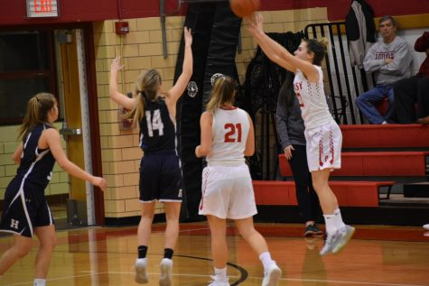 Sarah Weaver sinks a three-point shot.