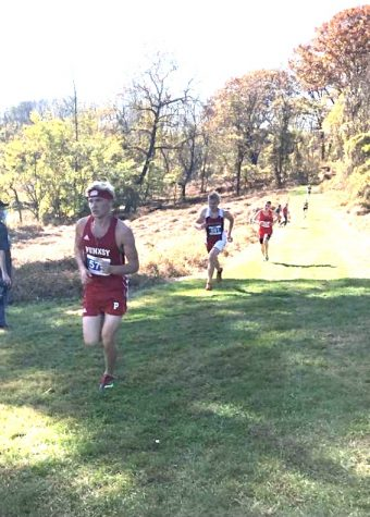 Aiden McLaughlin leads a group runners during one of Cross Country