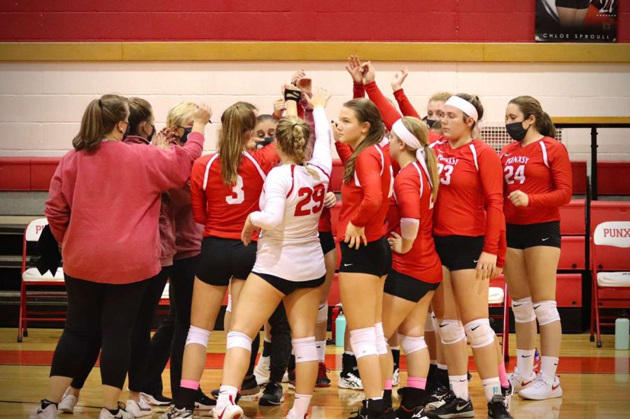 The+Varsity+volleyball+players+huddle+up+after+winning+a+game+during+the+regular+season.+