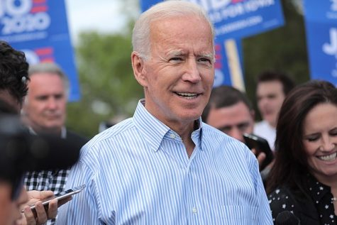 At a march in Iowa in August 2019, president-elect Joe Biden walks with his supporters. Joe Biden became president-elect when he reached 270 electoral votes on Saturday, eventually getting a total of 290 votes.