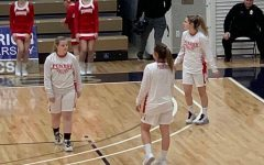 Last season, Izabella Martino, Sarah Weaver, and Riley Presloid warm up for a seasonal Girl's Basketball Game.