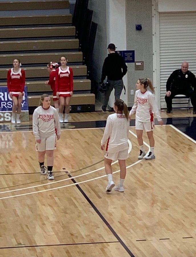 Last+season%2C+Izabella+Martino%2C+Sarah+Weaver%2C+and+Riley+Presloid+warm+up+for+a+seasonal+Girl%27s+Basketball+Game.