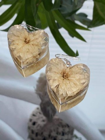 Contains hand picked and dried flowers incased into a heart shape.