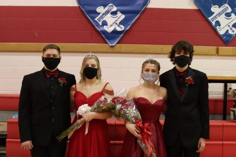 Princess Chloe Sproull (left) with her escort Daniel Kunselman stands for a picture with Queen Kaitlin Brauer (right) and her escort Braden Mohney. The crowns were donated by Paul Beatty Jewelers and Varsity Club bought the flowers for the girls.