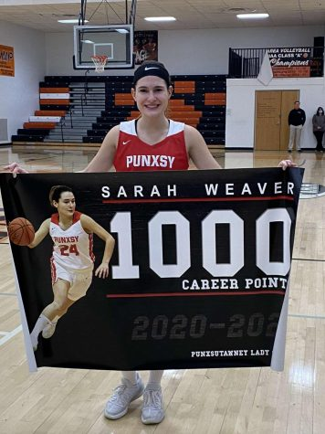 Sarah Weaver holds her banner after she surpasses the 1,000 point mark.