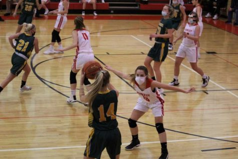Freshman Danielle Griebel guards a player from the opposing team.