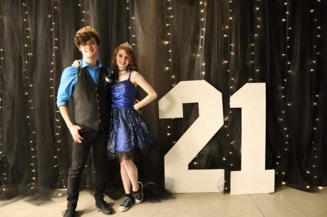 Winter and Ian pose for a picture as Prom King and Queen