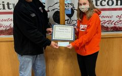 Bob Lott presents a certificate and a check for $100 to Elizabeth Vallies for her first place finish in the annual Patriots Pen essay contest sponsored by the local VFW.